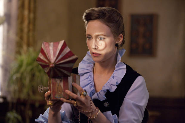 """In this publicity image released by Warner Bros. Pictures, Vera Farmiga portrays Lorraine Warren in a scene from """"The Conjuring."""" (AP Photo/New Line Cinema/Warner Bros. Pictures, Michael Tackett) ORG XMIT: NYET259"""