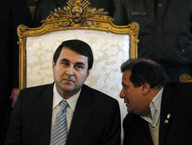 Paraguay's new President Federico Franco, left, listens to lawmaker Salustiano Salinas, from the Liberal Radical Authentic Party as he gives a news conference at the presidential palace in Asuncion, Paraguay, Saturday, June 23, 2012. Paraguay's newly sworn in president is promising to honor foreign commitments and reach out to Latin American leaders after the Senate removed President Fernando Lugo from office in a rapid impeachment trial on Friday. (AP Photo/Jorge Saenz)