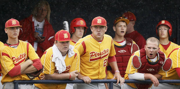 The Dale Pirates watch from the dugout as rain falls during a Class 2A state high school baseball championship semifinal game between Dale and Tushka at Palmer Field inside Dolese Park in Oklahoma City, Friday, May 11, 2012. Photo by Nate Billings, The Oklahoman