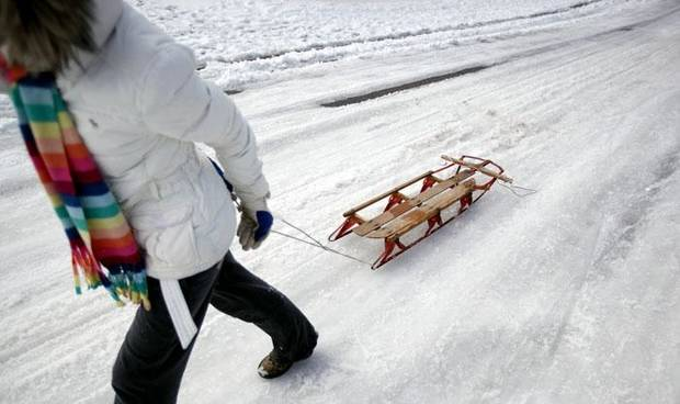 Claire McCoy's pulls her sled on hill in the Trails neighborhood, Saturday, Dec. 26, 2009, in Edmond, Okla. Photo by Sarah Phipps, The Oklahoman