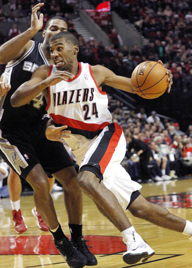 Portland Trail Blazers guard Ronnie Price, right, drives on San Antonio Spurs guard Gary Neal during the first half of their NBA basketball game in Portland, Ore., Saturday, Nov. 10, 2012. (AP Photo/Don Ryan)
