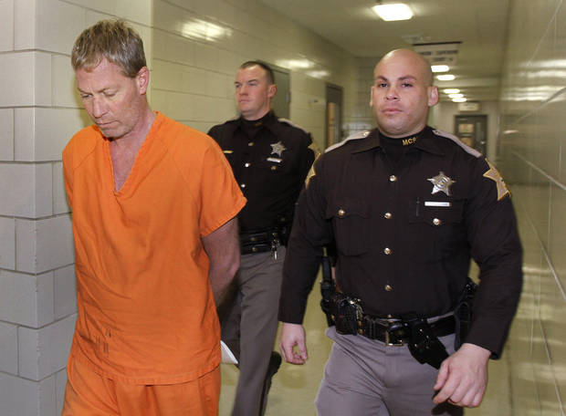 "Mark Leonard, left, returns to jail after entering a not guilty plea in the arraignment for the fatal Richmond Hill blast, at the City/County building, Monday, Dec. 24, 2012.  Monserrate Shirley, 47, her boyfriend, Mark Leonard, 43, and his half brother Robert ""Bob"" Leonard Jr., 54, are facing murder and several other felony charges in what authorities have called a senseless crime. (AP Photo/Indianapolis Star, Kelly Wilkinson)"