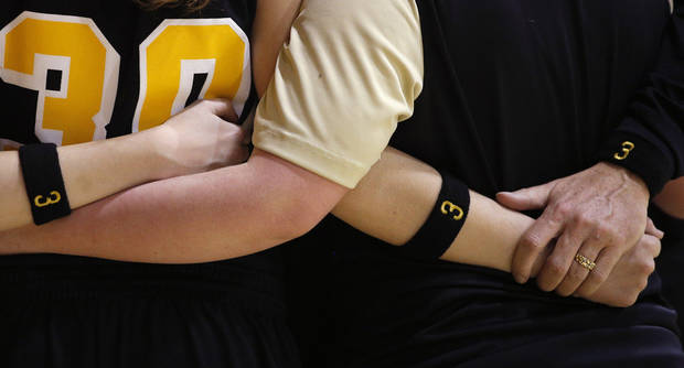 Members of the Cement girls basketball team wear wristbands with Seth Martin's number before the start of a girls basketball game in Cement, Okla., Wednesday, January 30, 2014. Seth Martin, 15, collapsed during Tuesday's game and later died at the hospital. Photo by Bryan Terry, The Oklahoman