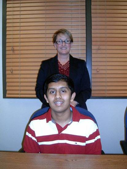 Deer Creek High School Principal Tracy Skinner stands behind student Soorajnath Boominathan, 14, who recorded a perfect ACT score.  PHOTO BY STEVE GUST, FOR THE OKLAHOMAN