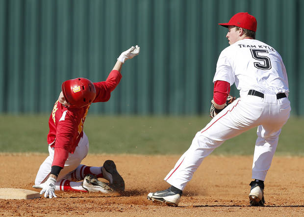 Dale's Tanner Nelson is out at second as Carl Albert's Justin McGregor turns to throw home in the first inning of their high school baseball game at Carl Albert in Midwest City, Okla., Thursday, March 14, 2013. Photo by Bryan Terry, The Oklahoman
