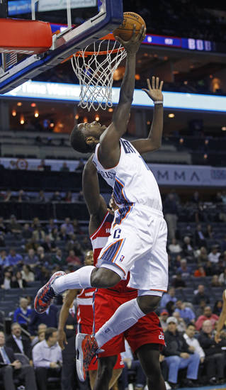 Charlotte Bobcats' Michael Kidd-Gilchrist, front, shoots over Washington Wizards' Emeka Okafor, back, during the first half of an NBA basketball game in Charlotte, N.C., Tuesday, Nov. 13, 2012. (AP Photo/Chuck Burton)