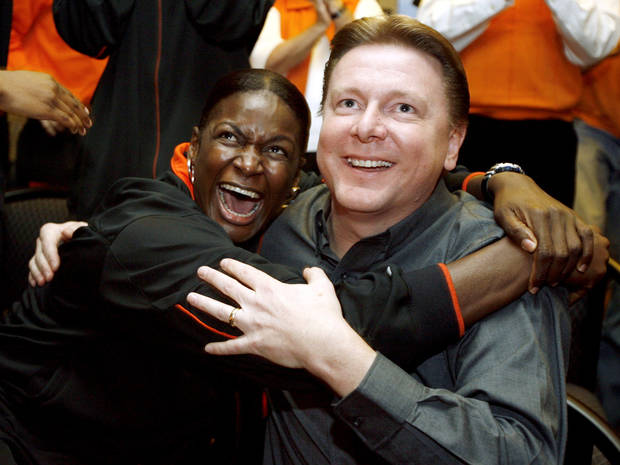 Rashidat Sadiq, left, and head coach Kurt Budke celebrate after hearing the Cowgirls announced as a 10-seed in the NCAA tournament during a watch party for the Oklahoma State University Cowgirls, at Boone Pickens Stadium in Stillwater, Okla., Monday, March 12, 2007. By Matt Strasen, The Oklahoman