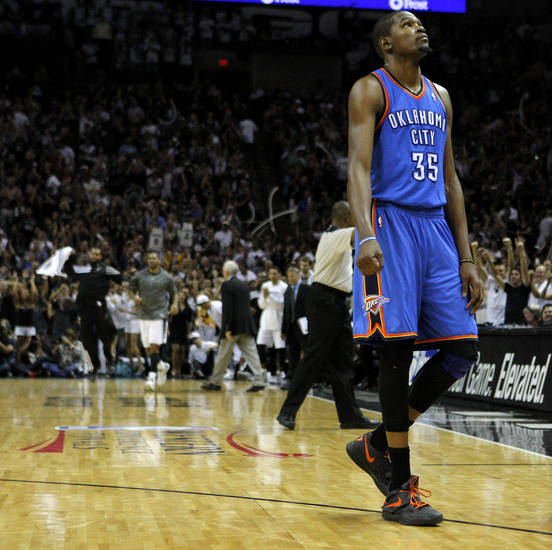 Oklahoma City's Kevin Durant (35) walks towards the bench as San Antonio celebrates during Game 2 of the Western Conference Finals between the Oklahoma City Thunder and the San Antonio Spurs in the NBA playoffs at the AT&T Center in San Antonio, Texas, Tuesday, May 29, 2012. Oklahoma City lost 120-111. Photo by Bryan Terry, The Oklahoman