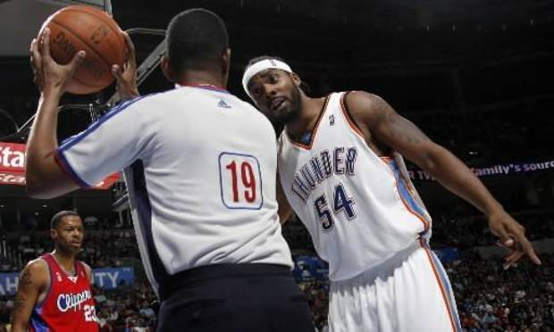 Chris Wilcox of the  Thunder expresses his frustration for a foul not being called with official James Capers in the second half of the NBA basketball game between the Oklahoma City  Thunder and the Los Angeles Clippers at the Ford Center in Oklahoma City Wednesday. Photo by Nate Billings