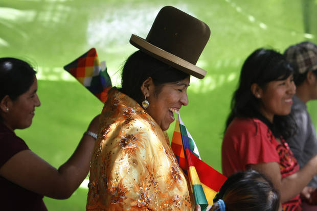 Bolivian women attend a People's Summit march, a parallel event created against the scheduled weekend 60-nation economic summit in Santiago, Chile, Sunday, Jan. 27, 2013. Leaders from the European Union, Latin America and the Caribbean gathered in Santiago for the 60-nation, three day economic summit. (AP Photo/Victor Ruiz Caballero)