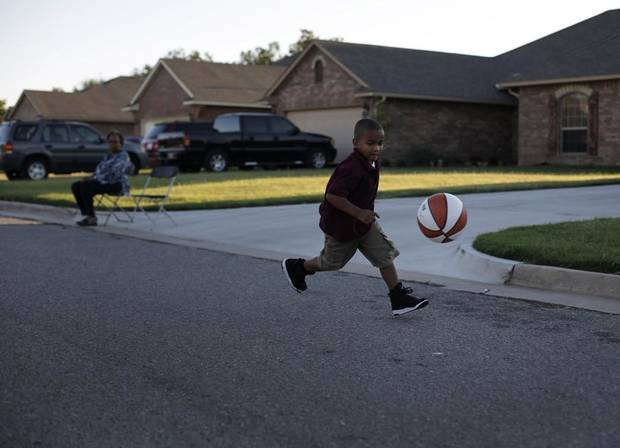 C.J. Williams, 5, plays with a basketball during a National Night Out event at the JFK Neighborhood in Oklahoma City, Tuesday, Sept. 11, 2012.  Photo by Garett Fisbeck, The Oklahoman