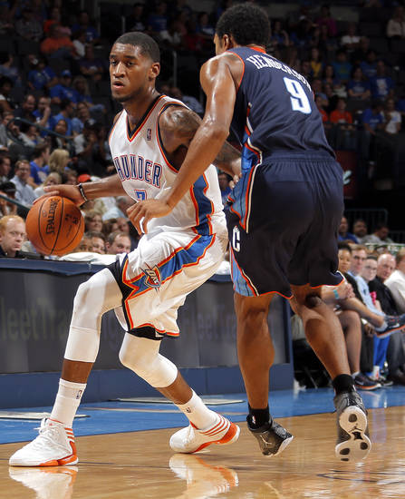 Oklahoma City's Perry Jones III (3) tries to get around Charlotte's Gerald Henderson (9) during the preseason NBA game between the Oklahoma City Thunder and the Charlotte Bobcats at Chesapeake Energy Arena in Oklahoma City, Tuesday, Oct. 16, 2012. Photo by Sarah Phipps, The Oklahoman