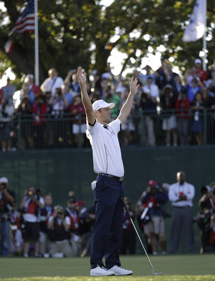 Europe's Martin Kaymer celebrates after winning the Ryder Cup PGA golf tournament Sunday, Sept. 30, 2012, at the Medinah Country Club in Medinah, Ill. (AP Photo/David J. Phillip)  ORG XMIT: PGA206