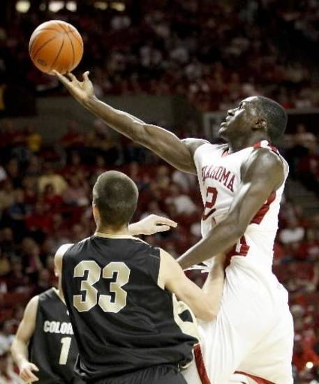OU's  Juan  Pattillo goes to the basket over Colorado's Austin Dufault during the Big 12 college basketball game between the University of Oklahoma (OU) and Colorado at Lloyd Noble Arena in Norman, Okla., Saturday, Feb. 7, 2009. PHOTO BY BRYAN TERRY