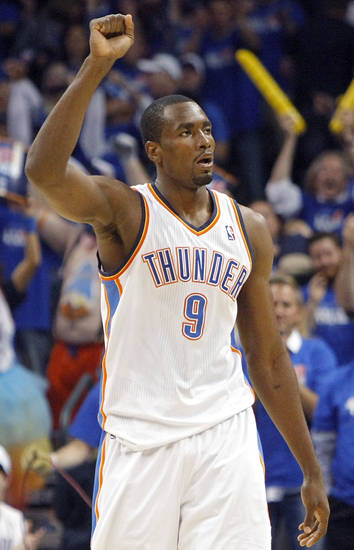 Oklahoma City&#039;s Serge Ibaka celebrates the Thunder win against  Denver during the first round NBA Playoff basketball game between the Thunder and the Nuggets at OKC Arena in downtown Oklahoma City on Wednesday, April 20, 2011. The Thunder beat the Nuggets 106-89 and lead the series 2-0. Photo by John Clanton, The Oklahoman