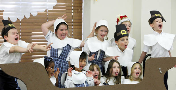 First-graders dressed as pilgrims pose for a silly-face photo after the Thanksgiving pageant at St. Mary&acirc;s Episcopal School.