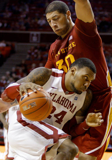 Oklahoma's Romero Osby (24) drives past Iowa State's Royce White (30) during an NCAA basketball game between the University of Oklahoma Sooners (OU) and the Iowa State Cyclones (ISU) at the Lloyd Noble Center in Norman, Saturday, Feb. 4, 2012. Photo by Bryan Terry, The Oklahoman