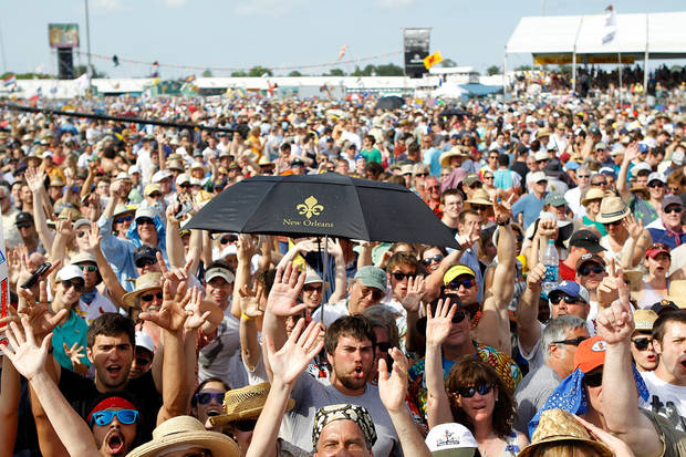 The crowd reacts as Bruce Springsteen and the E Street Band play the Acura Stage at the 2012 New Orleans Jazz and Heritage Festival presented by Shell on Sunday, April 29, 2012. (AP Photo/The Times-Picayune, David Grunfeld) MAGS OUT; NO SALES; USA TODAY OUT