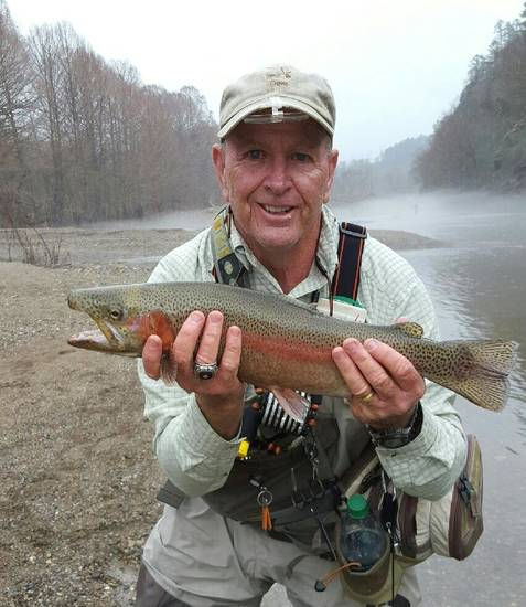 "David Diefenderfer of Oklahoma CityI caught this 22-inch rainbow trout Saturday at the Lower Mountain Fork River. ""It was probably the prettiest rainbow I ever caught,"" he said."
