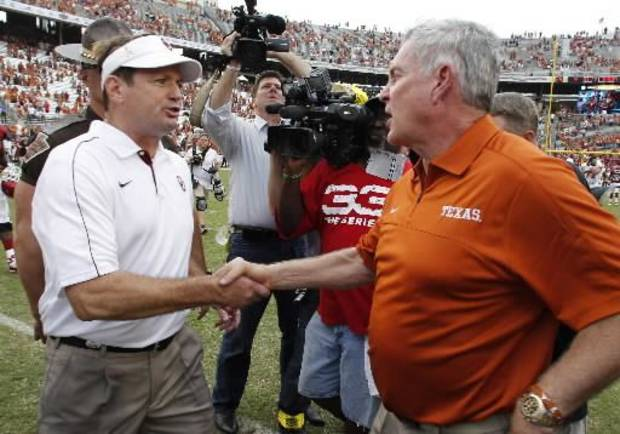 Oklahoma coach Bob Stoops and Texas coach Mack Brown shake hands after after the 107th Red River Rivalry. (AP Photo/LM Otero)