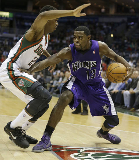 Sacramento Kings' Tyreke Evans (13) drives against Milwaukee Bucks' Doron Lamb, left, during the first half of an NBA basketball game on Wednesday, Dec. 12, 2012, in Milwaukee. (AP Photo/Jeffrey Phelps)