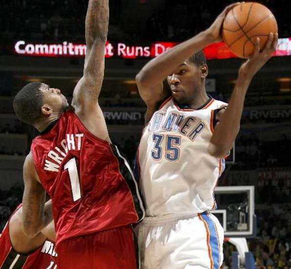 Oklahoma City's  Kevin  Durant drives around Miami's Dorell Wright during the NBA basketball game between the Oklahoma City Thunder and the Miami Heat at the Ford Center in Oklahoma City, Saturday, January 16, 2010. Photo by Bryan Terry