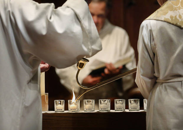At St. Paul�s Episcopal Cathedral in Oklahoma City, 28 small white candles are lit at the beginning of a service remembering those who died as a result of a Connecticut shooting massacre. Photo by Jim Beckel, The Oklahoman