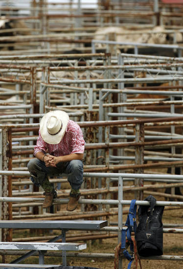 A cowboy waits for the start of the final round of the International Finals Youth Rodeo (IFYR) in Shawnee, Okla., Saturday, July 18, 2009. By Nate Billings, The Oklahoman