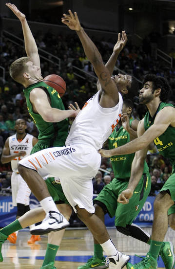 OSU's Marcus Smart loses the handle on the ball as Oregon's E.J. Singler and Arsalan Karzemi defend him in the second round of the NCAA Basketball tournament in San Jose, CA, Mar. 21, 2013. STEPHEN PINGRY/Tulsa World