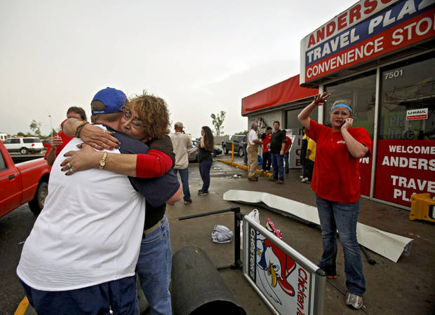 Staci Harris, left, hugs fellow employee Stacey Hendley outside the Anderson Travel Plaza after a tornado damaged the area around I-40 and Choctaw Road on Monday, May 10, 2010, in Oklahoma City, Okla.  Photo by Chris Landsberger, The Oklahoman