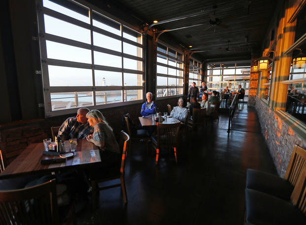 People watch the sun set at Redrock Canyon Grill in Oklahoma City, Monday, Nov. 5, 2012. Photo by Nate Billings, The Oklahoman
