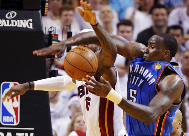 Oklahoma City's Kendrick Perkins (5) and Miami's LeBron James (6) battle for the ball during Game 3 of the NBA Finals between the Oklahoma City Thunder and the Miami Heat at American Airlines Arena, Sunday, June 17, 2012. Photo by Bryan Terry, The Oklahoman