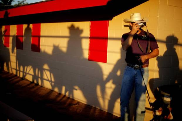 CHILD / CHILDREN / KIDS: Chantz Whitehead takes photos of the grand entry before the Edmond Junior Rodeo on Friday,  May 7, 2010.  Photo by Bryan Terry, The Oklahoman ORG XMIT: KOD