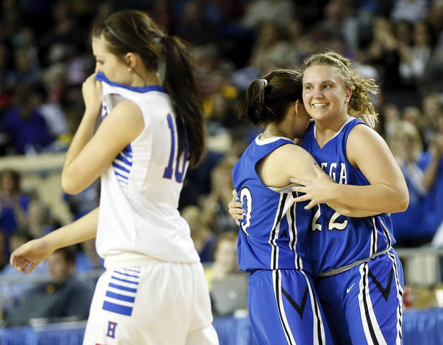 Lomega's Ashley LaGasse (22), right, and Kylie Turner (10) hug as Hammon's Kala Morris (10) leaves the court after a Class B Girls semifinal game of the state high school basketball tournament between Hammon and Lomega at Jim Norick Arena, The Big House, on State Fair Park in Oklahoma City, Friday, March 1, 2013. Lomega won, 60-52. Photo by Nate Billings, The Oklahoman