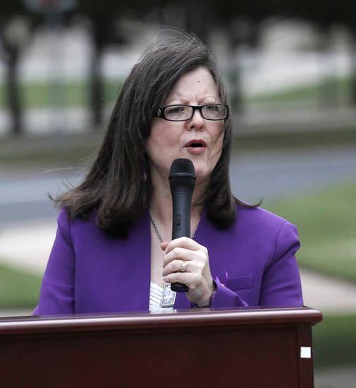 Lesley March, with the Attorney General's office, speaks during a ceremony to remember victims of domestic violence at the Capitol in Oklahoma City, Thursday, October 4, 2012.  Photo by Doug Hoke, The Oklahoman