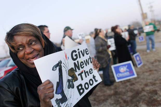 Christine Byrd holds a sign as Obama supporters gather at Democratic headquarters across the street from a Newt Gingrich rally held at the Oklahoma Sports Hall of Fame on Lincoln Boulevard Monday, Feb. 20, 2011. Photo by Doug Hoke, The Oklahoman