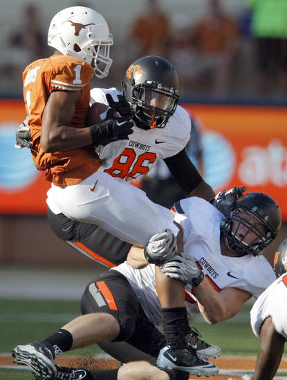Oklahoma State&#039;s Wilson Youman (86) and Caleb Lavey (45) tackle Texas&#039; Mike Davis (1) during second half of a college football game between the Oklahoma State University Cowboys (OSU) and the University of Texas Longhorns (UT) at Darrell K Royal-Texas Memorial Stadium in Austin, Texas, Saturday, Oct. 15, 2011. Photo by Sarah Phipps, The Oklahoman  
