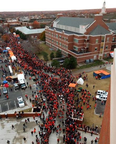 The OSU team makes their way to the stadium during the Spirit Walk before the Bedlam college football game between the Oklahoma State University Cowboys and the University of Oklahoma Sooners at Boone Pickens Stadium in Stillwater, Okla., Saturday, Dec. 3, 2011. Photo by Bryan Terry, The Oklahoman