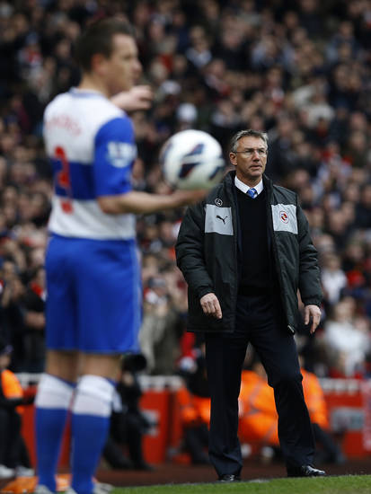 Reading's new manager Nigel Adkins looks on as his player Nicky Shorey prepares to take a throw on during the English Premier League soccer match between Arsenal and Reading at the Emirates Stadium in London, Saturday, March 30, 2013. (AP Photo/Kirsty Wigglesworth)