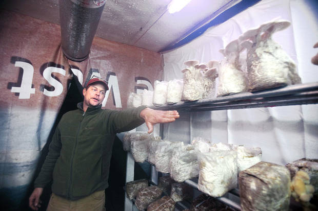 Robert Wehrle, grow room manager at Oklahoma Mushroom, talks about mushroom cultivation inside the farm, a converted semitrailer.