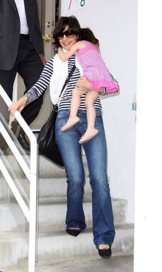 Katie Holmes carries Suri as she leaves dance class. Guess what Katie's wearing? Her favorite Joe's jeans in the Muse fit.