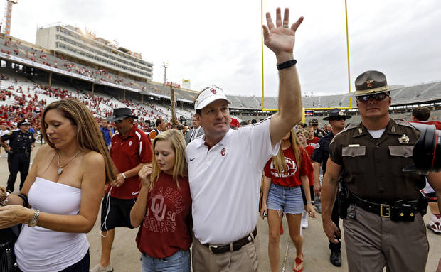 Bob Stoops salutes the fans as he leaves the field after the 63-21 win over Texas during the Red River Rivalry college football game between the University of Oklahoma (OU) and the University of Texas (UT) at the Cotton Bowl in Dallas, Saturday, Oct. 13, 2012. Photo by Chris Landsberger, The Oklahoman