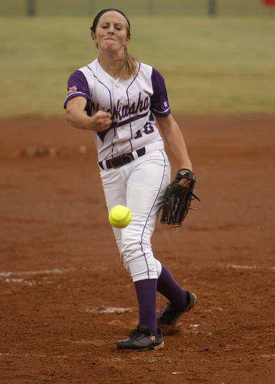 Chickasha's Kelsi Gore (18) pitches during a 5A state softball semifinals game between Edmond North and Yukon at ASA Hall of Fame Stadium in Oklahoma City, Okla., Friday, Oct. 12, 2012.  Photo by Garett Fisbeck, The Oklahoman