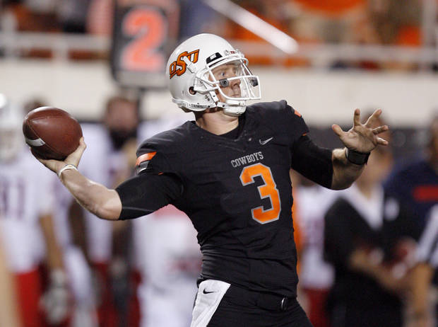 Oklahoma State's Brandon Weeden throws a pass during the Cowboys 37-14 win over Arizona on Thursday in Stillwater. PHOTO BY BRYAN TERRY, The Oklahoman