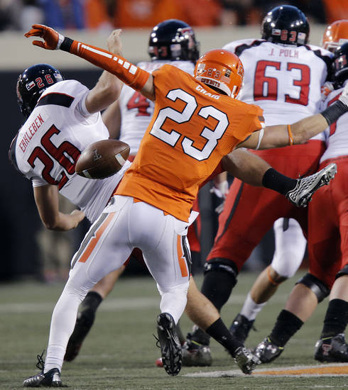 Oklahoma State's Zack Craig (23) blocks  a kick by Texas Tech's Ryan Erxleben (26) during the college football game between the Oklahoma State University Cowboys (OSU) and Texas Tech University Red Raiders (TTU) at Boone Pickens Stadium on Saturday, Nov. 17, 2012, in Stillwater, Okla.   Photo by Chris Landsberger, The Oklahoman