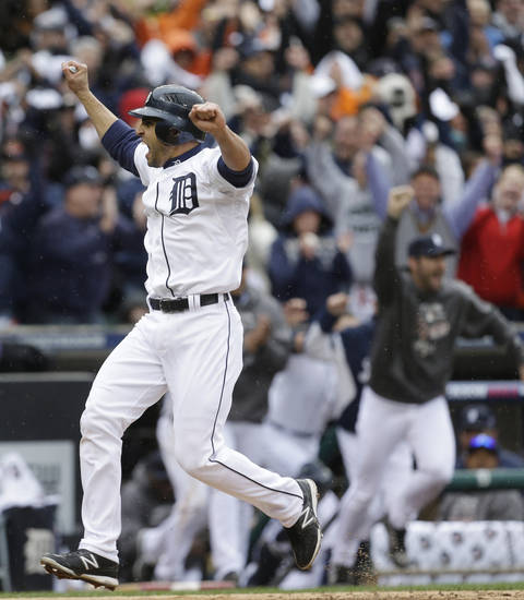 Detroit Tigers' Omar Infante scores the winning run in the ninth inning on a sacrifice fly by teammate Don Kelly in Game 2 of the American League division baseball series, Sunday, Oct. 7, 2012, in Detroit. (AP Photo/Paul Sancya)