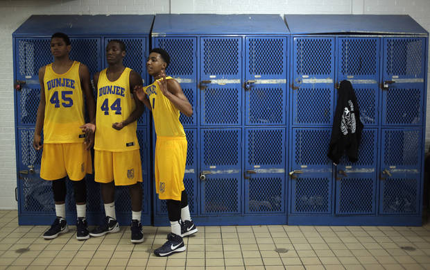Star Spencer players pose for a photo in the locker room with their Dunjee uniforms after a high school basketball game between Star Spencer and Astec in Spencer, Okla., Monday, Feb. 11, 2013.  Photo by Garett Fisbeck, For The Oklahoman