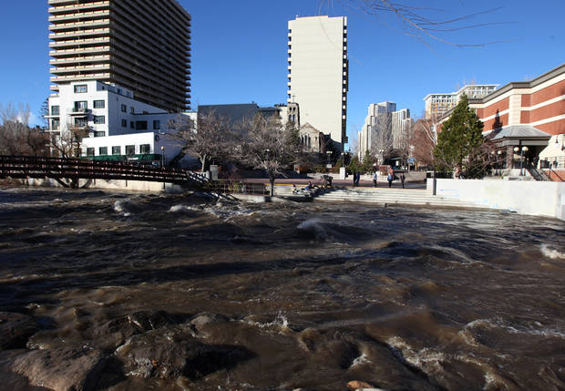 The Truckee River, in downtown Reno, Nev., swelled as a heavy, wet storm hits the Northern Nevada region on Sunday, Dec. 2, 2012. The storm delivered more snow and less rain than forecast, blunting the flood danger. (AP Photo/Cathleen Allison)