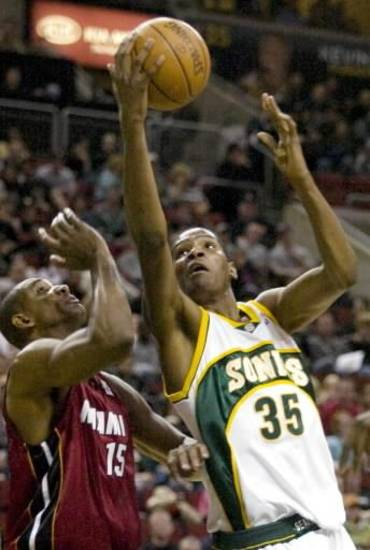 Seattle SuperSonics' Kevin  Durant, right, goes to the basket past Miami Heat's Mark Blount during the second half in an NBA basketball game Friday, Feb. 29, 2008, in Seattle.  Durant scored 24 points in the SuperSonics 93-103 loss to the Heat. (AP Photo/Jim  Bryant)