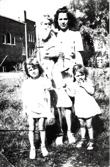 Pictured are  Elnora Marts (mother), standing on the left is Sabra Marts, standing on the right is Sue Marts (Sue Alexander), and the baby being held is Charlie Marts.  Photo was taken in Woodward, days before the Woodward tornado in April of 1947, near the intersection of US 412 and US 270 (9th & Oklahoma Avenue) in Woodward. I recognize the building in the background as the Woodward Municipal Building/Fire and Police Department. ORG XMIT: KOD